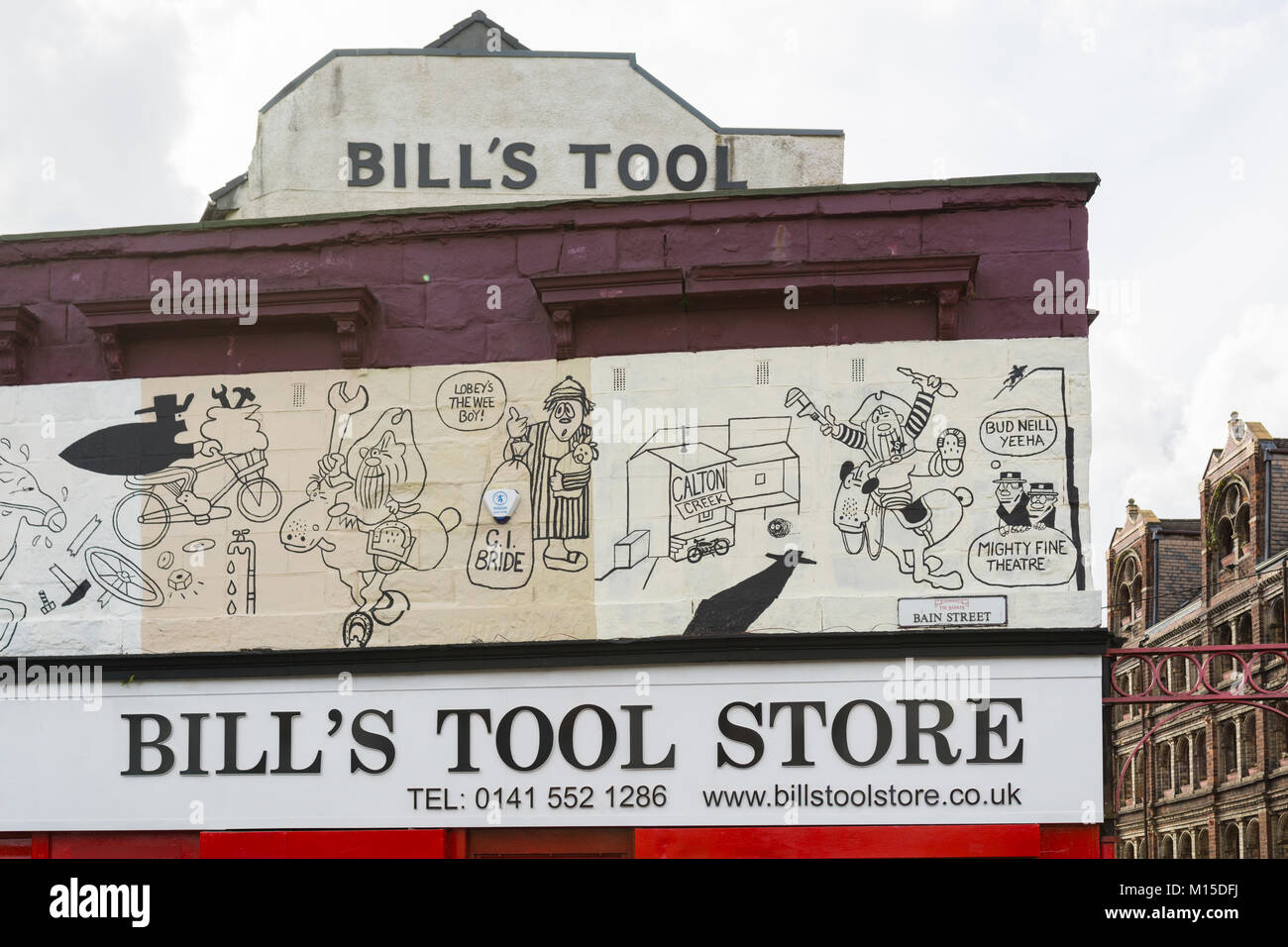 Bill's Tool store and Lobey Dosser mural at The Barras, Gallowgate, Glasgow, Scotland, UK - Stock Image
