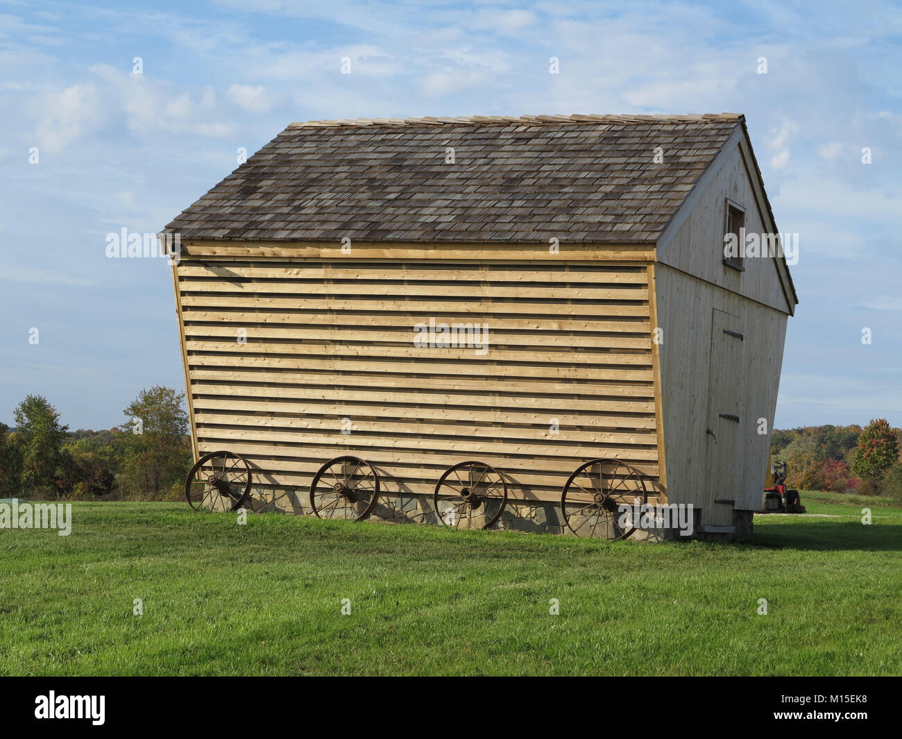 Picturesque Wooden Barn on a Grassy Field Stock Photo