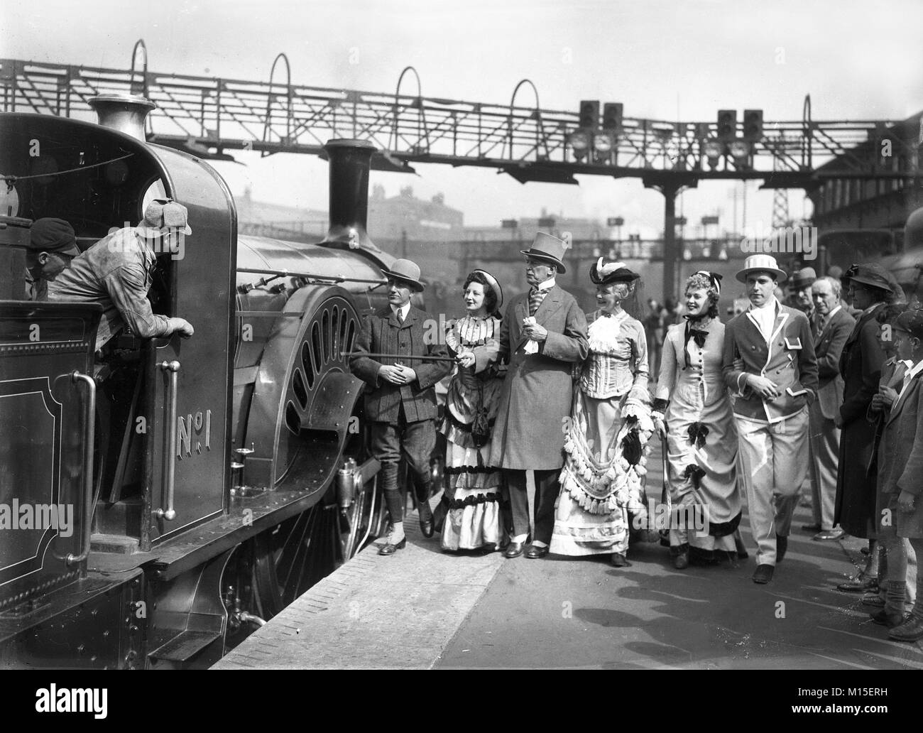 Passengers dressed in period costume with the preserved Stirling Single No 1 steam locomotive pulling an RCTS excursion - Stock Image