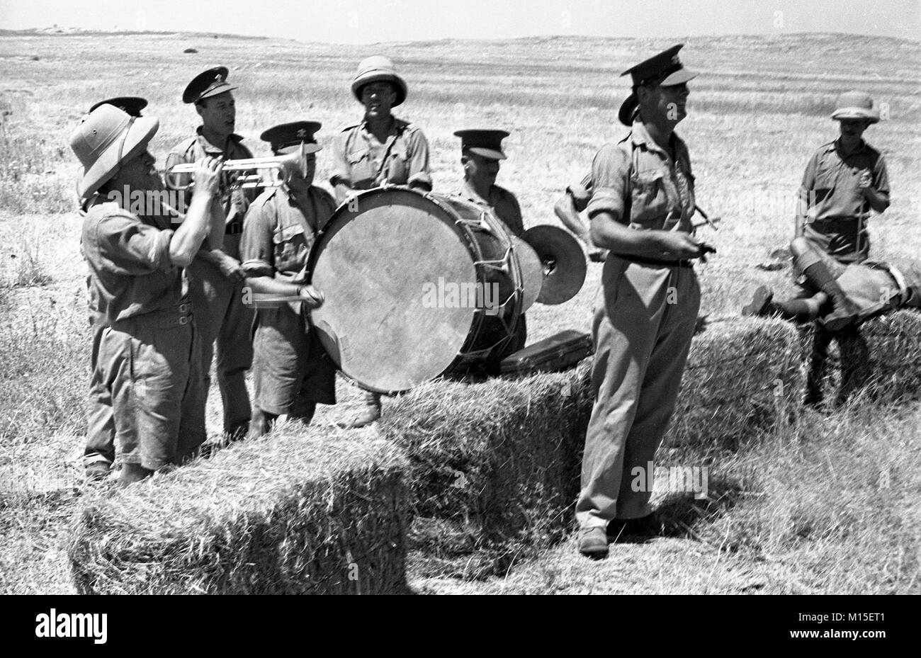 British army soldiers and miltary band having fun and entertainment in Palestine 1940 - Stock Image