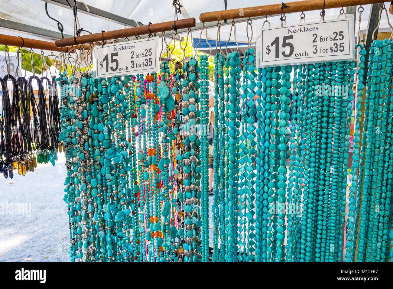 Necklaces and bracelets for sale at a stall in Port Douglas market,Port Douglas Queensland,Australia - Stock Image