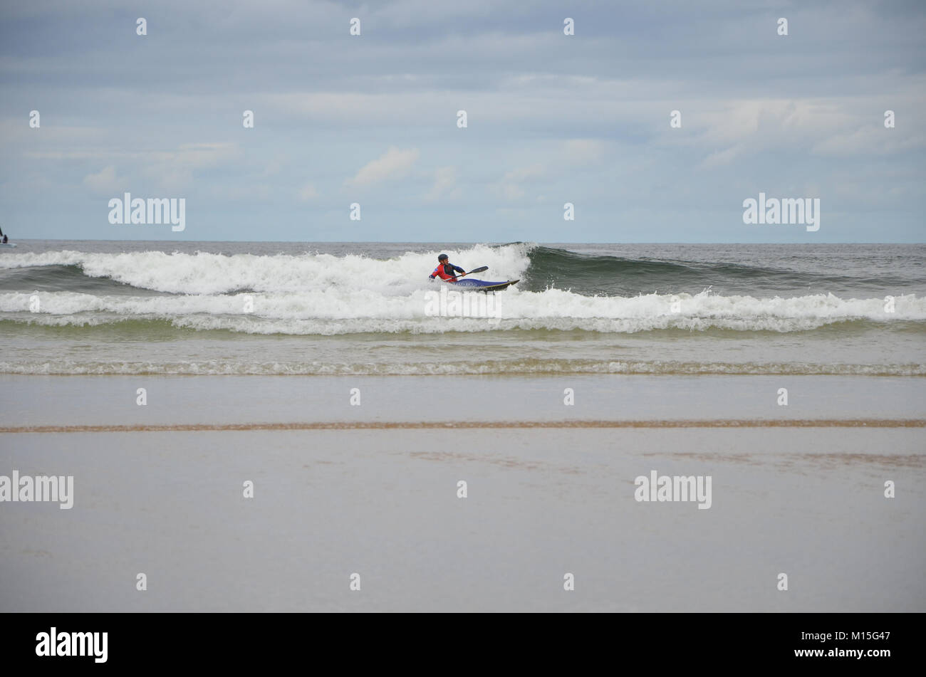 Portrush, Co.Antrim, Northern Ireland. August 6th 2013 A Kayaker tackles the waves in West Bay Portrush - Stock Image