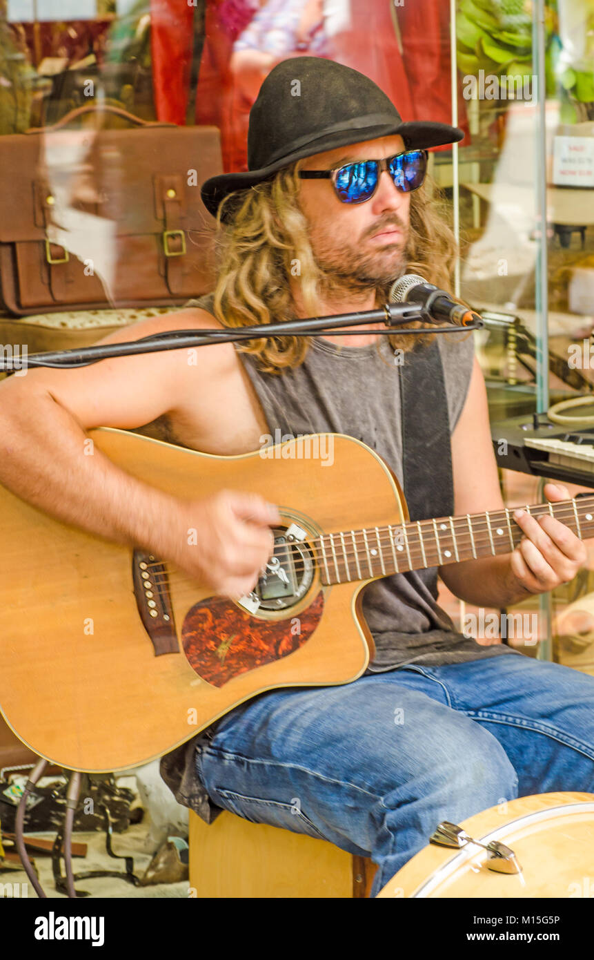 Vocalist and guitar player Matty Rogers busking in Tamworth Australia's Country Music Festival 2018. - Stock Image