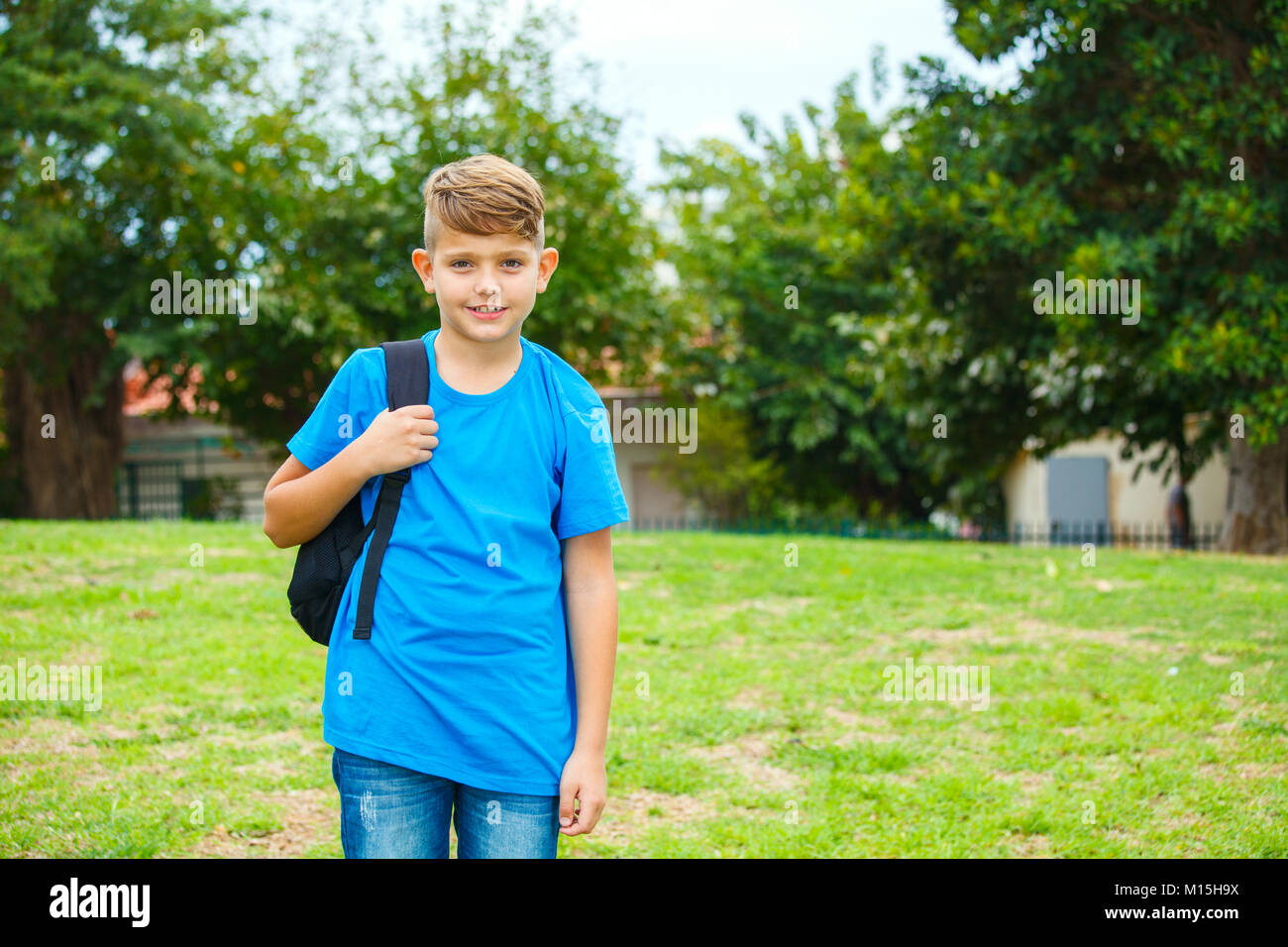 School Boy with backpack at the park - Stock Image