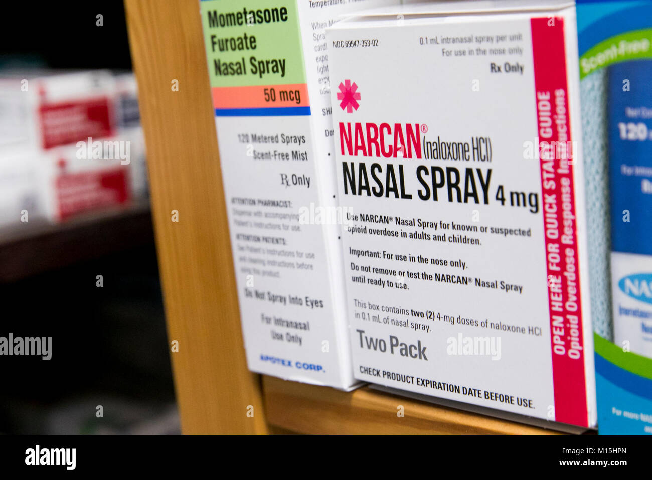 A box of Narcan (Naloxone) nasal spray for treating Opioid overdoses as seen on a pharmacy shelf. - Stock Image