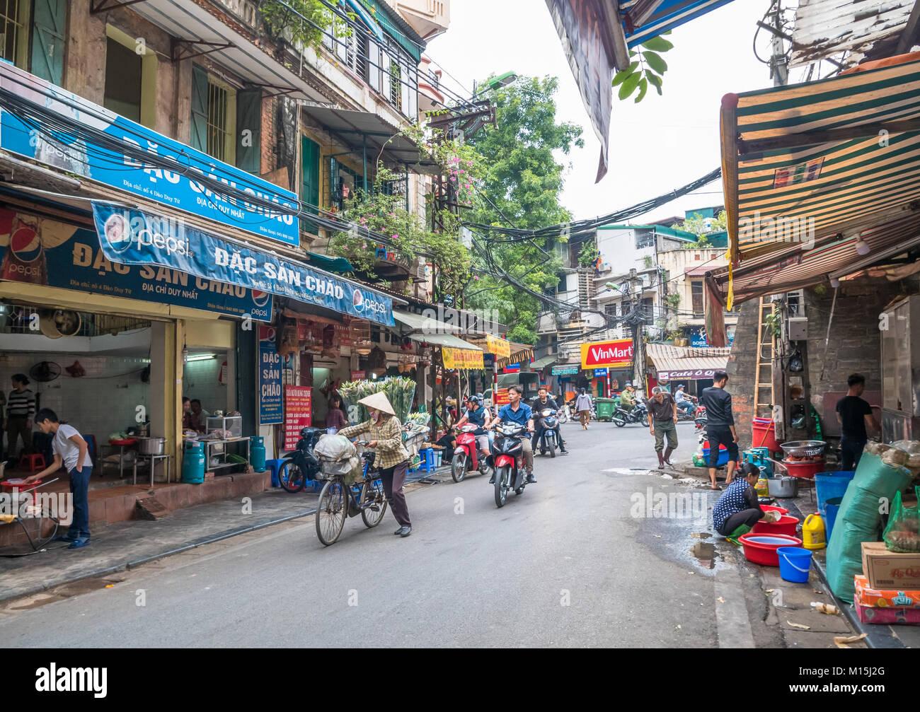 Hanoi,Vietnam - November 6,2017 : Local daily life of the street in Hanoi, Vietnam. Street vendors selling various Stock Photo