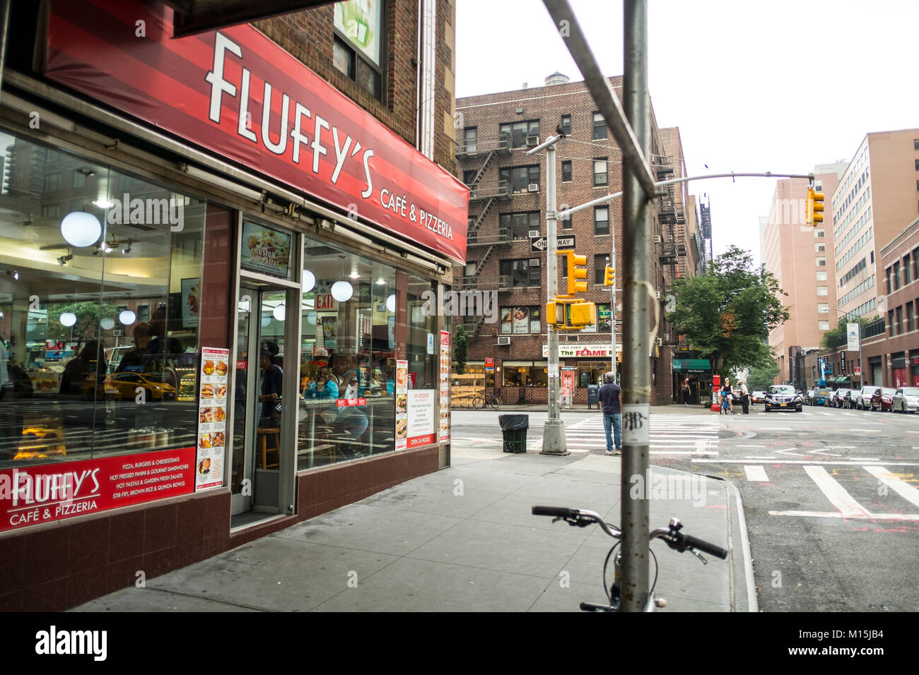 Fluffy's is a comfortable and reasonably priced joinyt at the corner of West 5th Street and 9th Avenue. Eateries - Stock Image