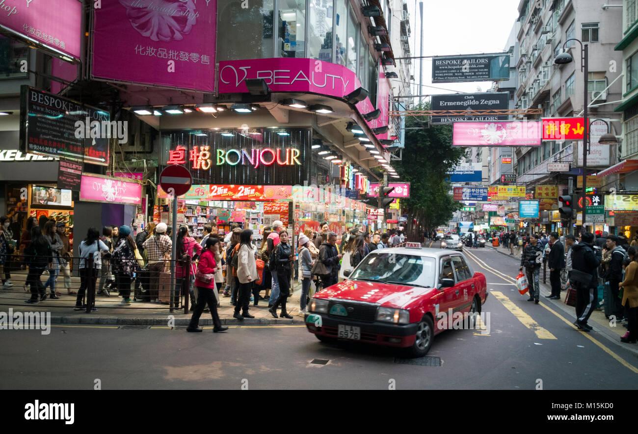 Busy shopping street in Tsim Sha Tsui, Hong Kong - Stock Image