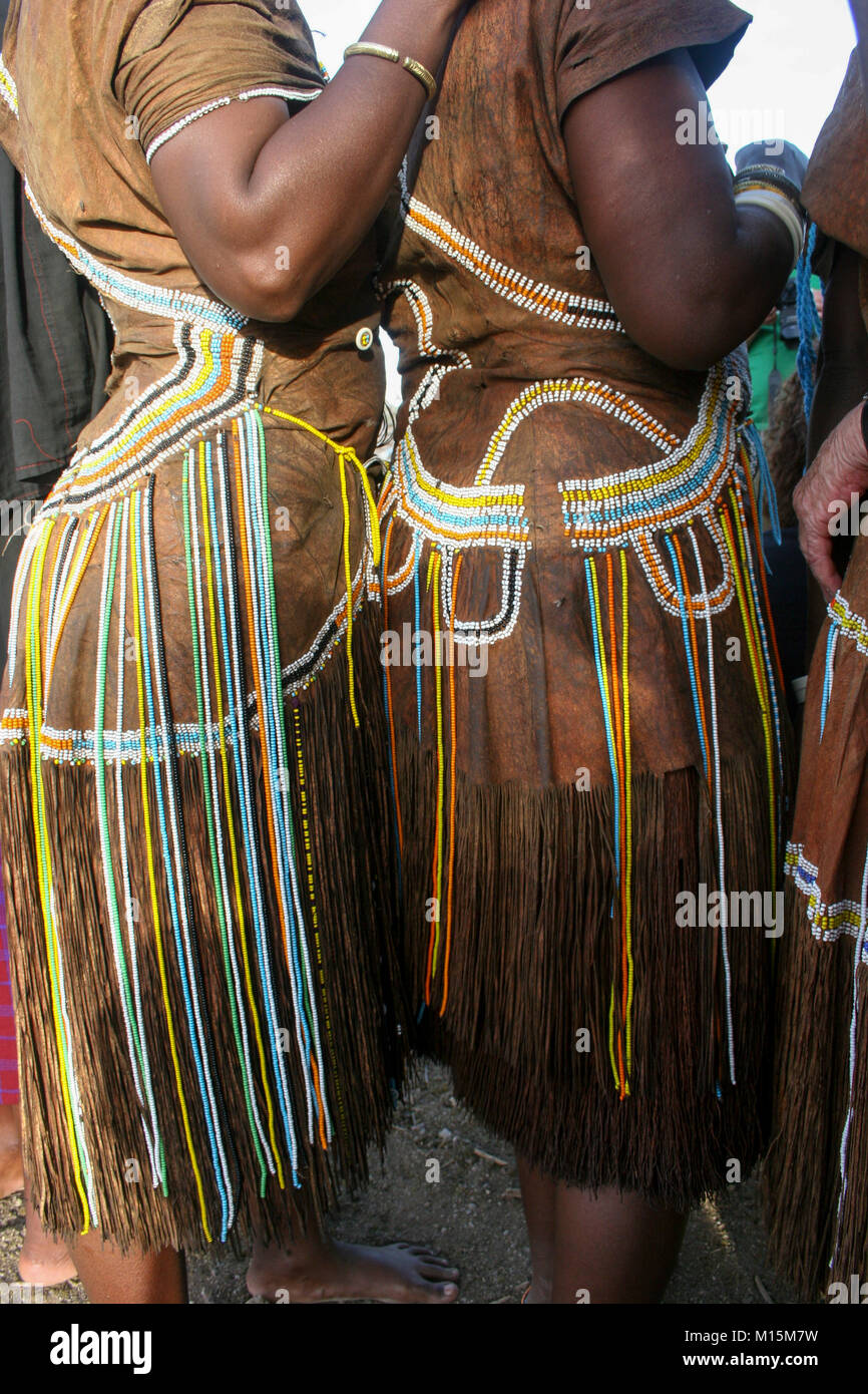 Datoga woman in traditional leather dress adorned with beads and brass bracelets - Stock Image
