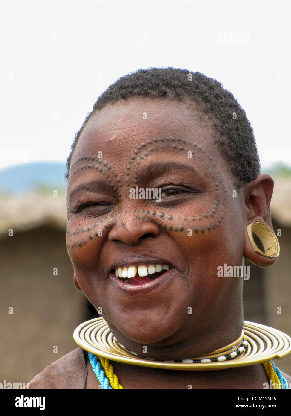 Portrait of a young Datoga woman with beauty scarring around her eyes. Photographed at Lake Eyasi, Tanzania - Stock Image