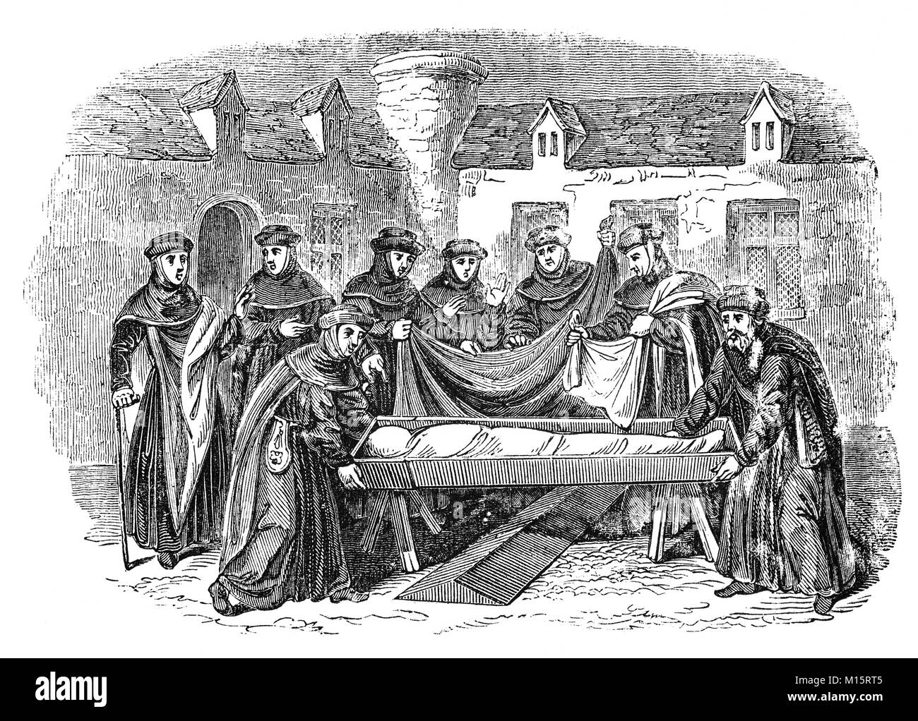 The burial ceremony of a deceased monk in a 14th Century English convent. - Stock Image
