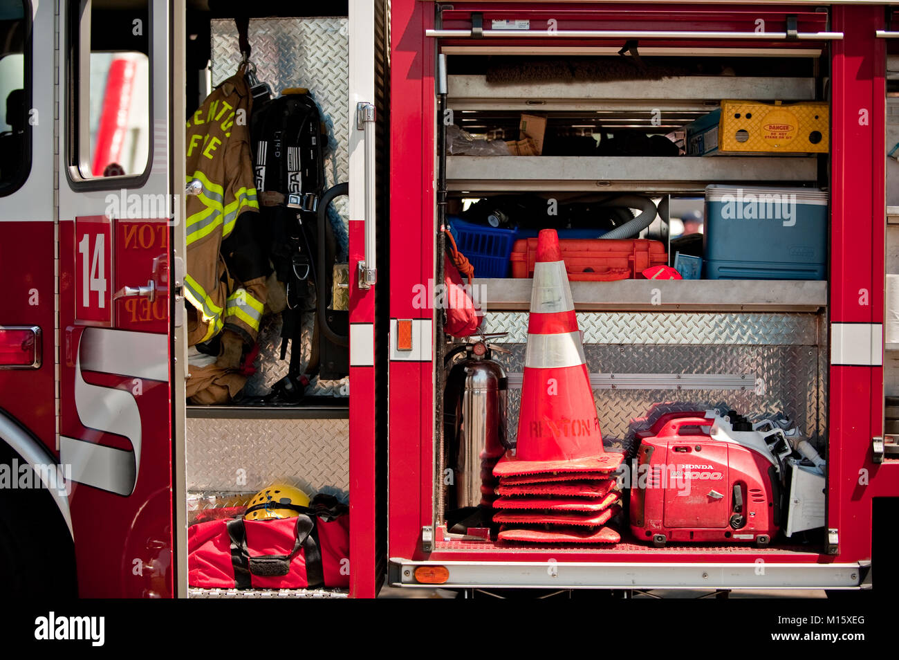 Fire fighting equipment on display inside a fire truck - Stock Image