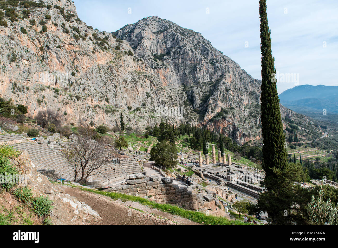 Apollo Temple in Delphi and ancient theatre, an archaeological site in Greece, at the Mount Parnassus. Delphi is - Stock Image