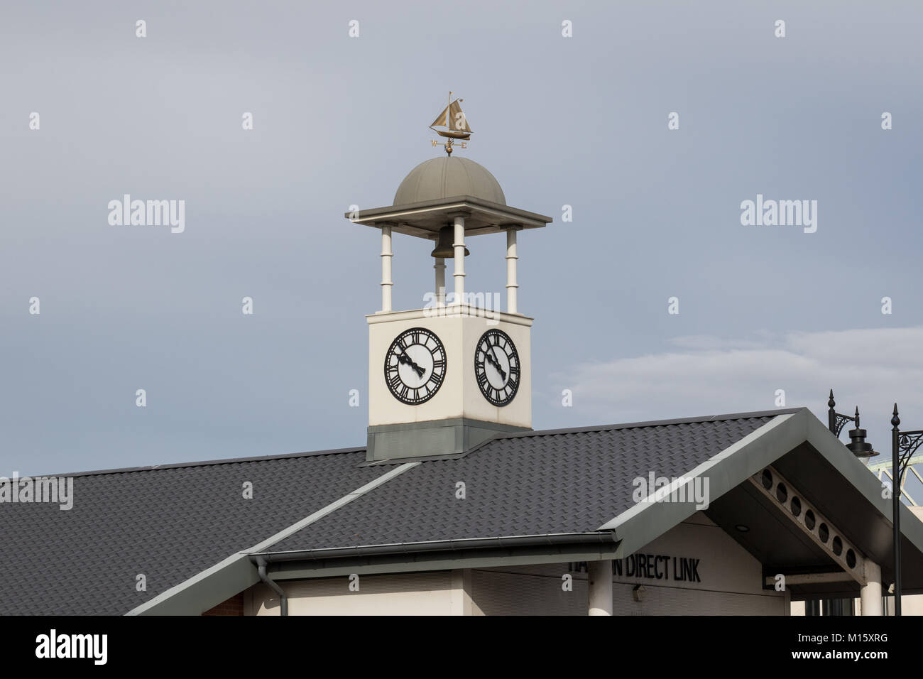 Small tower with bell, clock and weather vane with model ship on the rooftop - Halton Direct Link building, Runcorn, - Stock Image