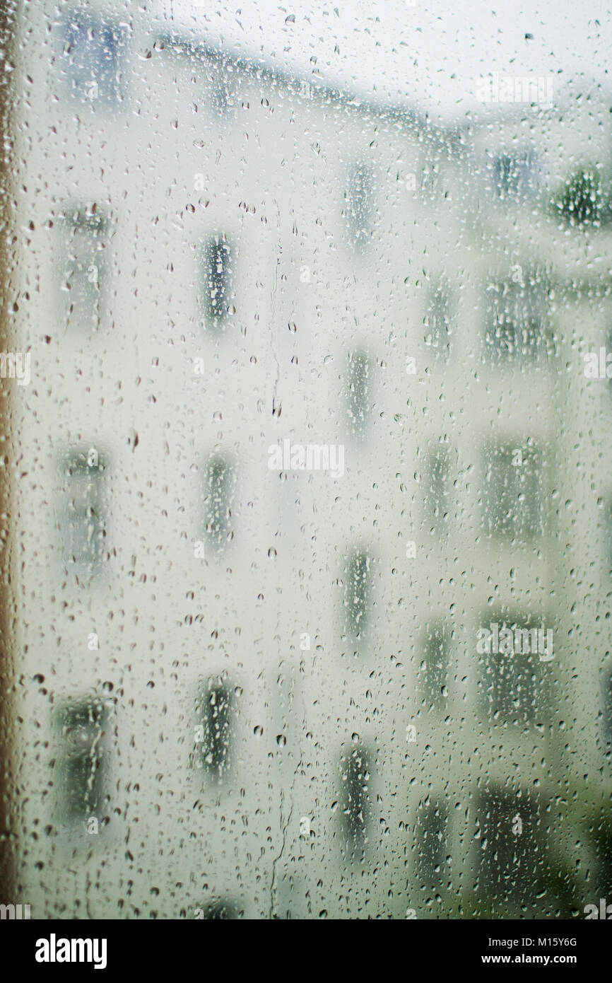Symbol picture loneliness,depression,window pane with raindrops - Stock Image