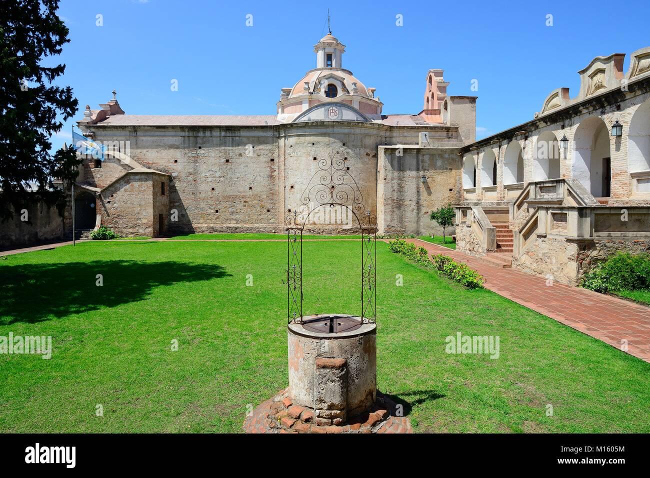 Draw well and Church of the Jesuit Mission,Museo Estancia Jesuitica,Alta Gracia,Province of Córdoba,Argentina - Stock Image
