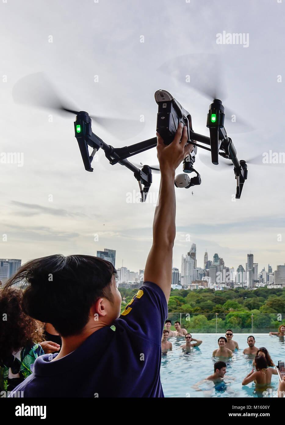 Man launches DJI Inspire 1 drone,Bangkok,Thailand - Stock Image