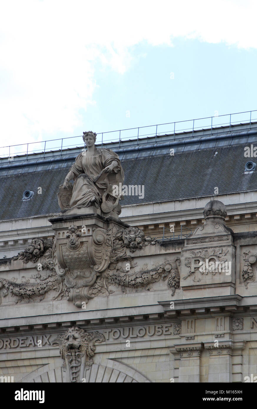 Statue with Book on the Roof Terrace of the Orsay Museum, Paris, France. Stock Photo