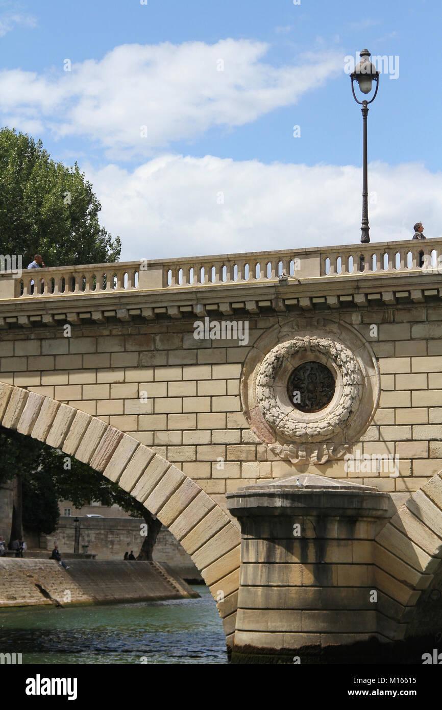 Close up of an arch and pier of bridge 11 (Pont Louis Philippe), Seine River, Paris, France. - Stock Image
