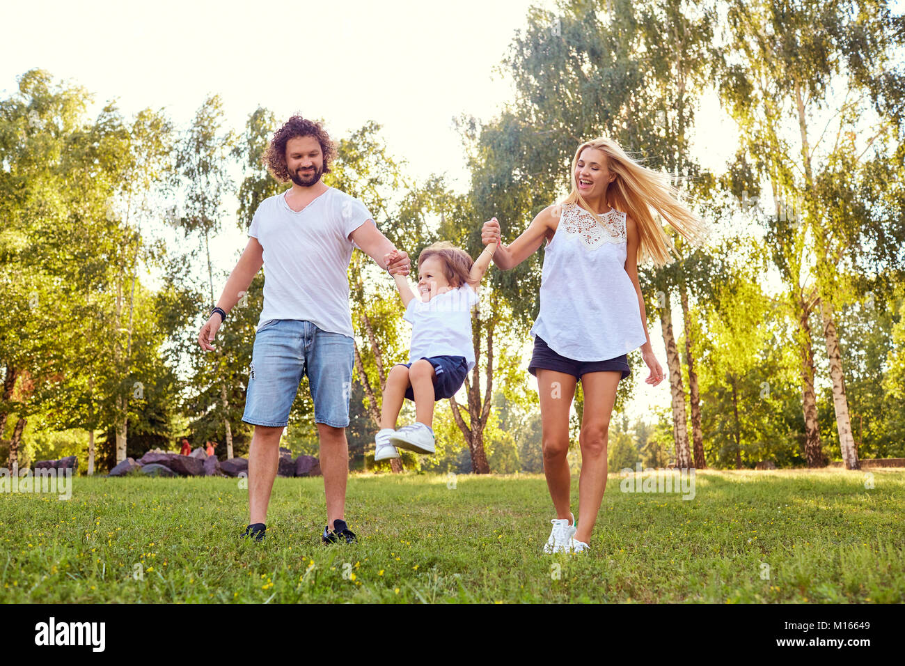 Happy family in the park.  - Stock Image