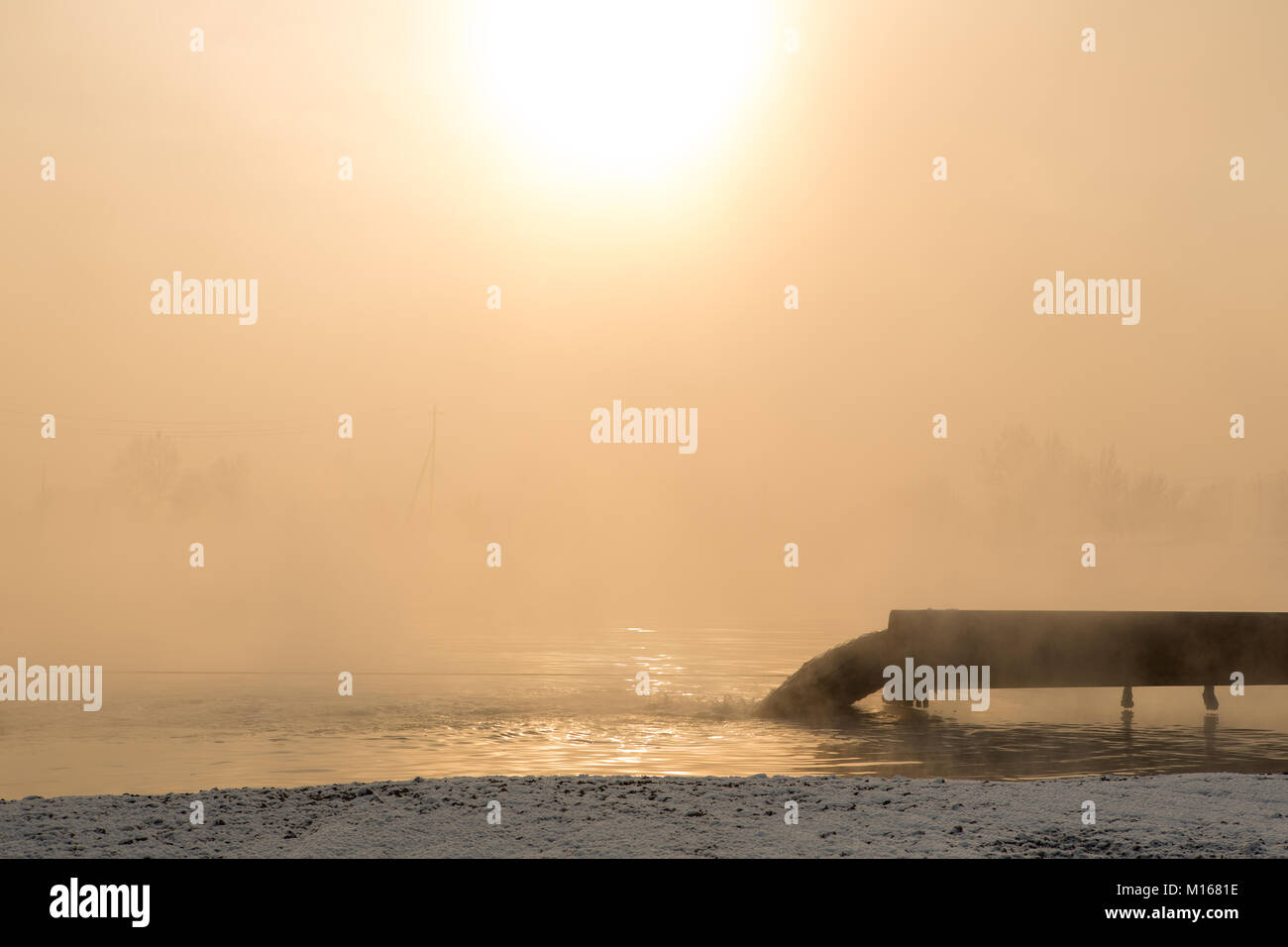 Dirty water discharged into the river, pollution - Stock Image