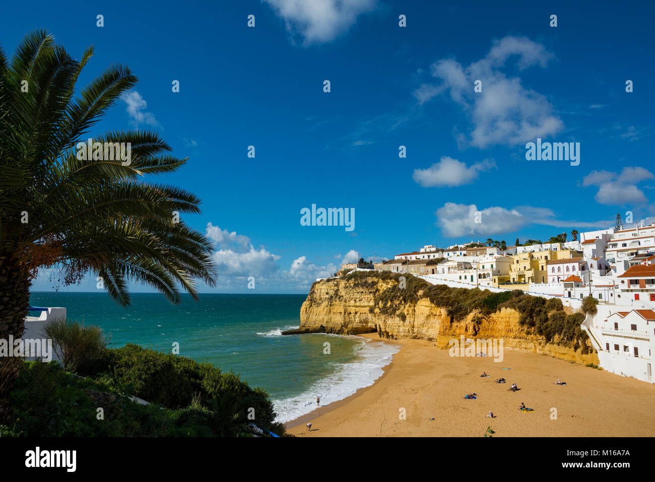 Bay with beach and colourful houses, Carvoeiro, Algarve, Portugal Stock Photo