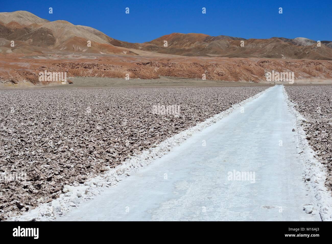 Road through Salzfeld, Salar de Atacama, near San Pedro de Atacama, Región de Antofagasta, Chile Stock Photo