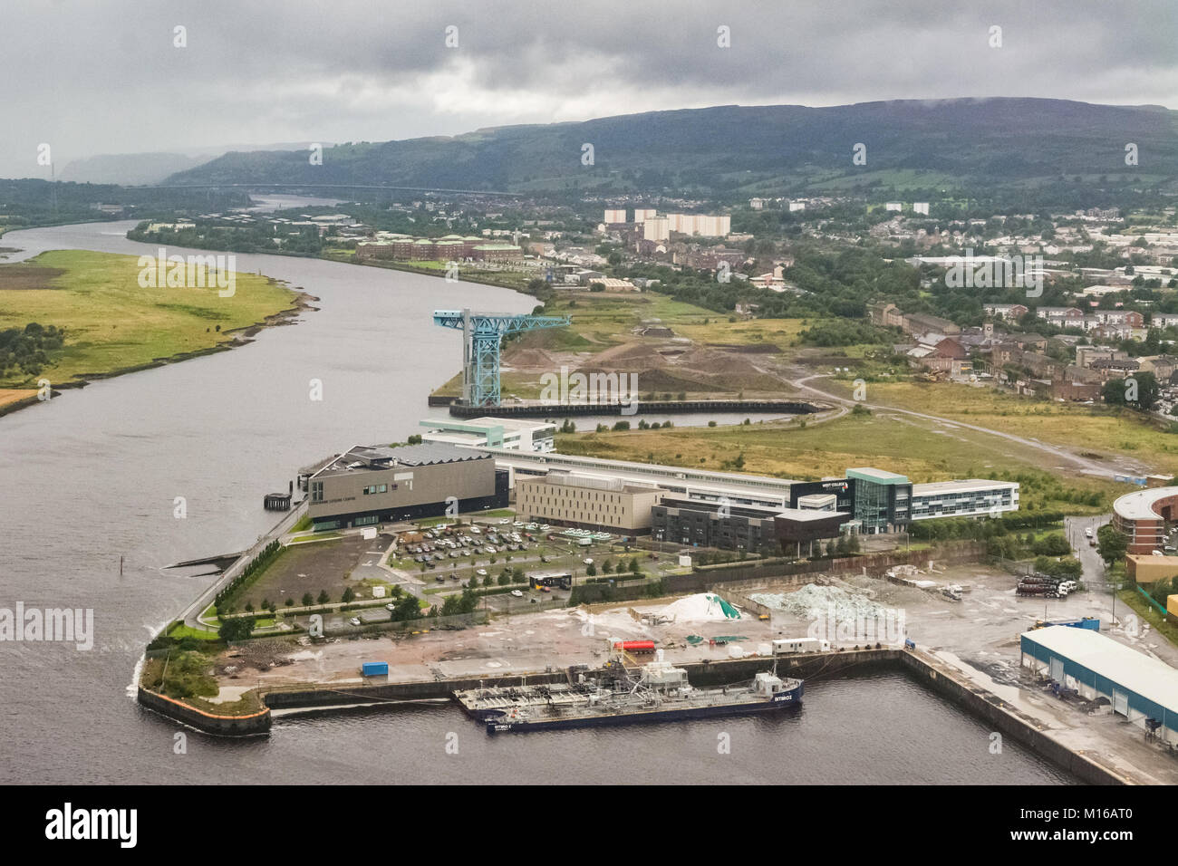 Clydebank, Glasgow, Scotland, UK - showing West College Scotland and the empty former site of the John Brown's - Stock Image