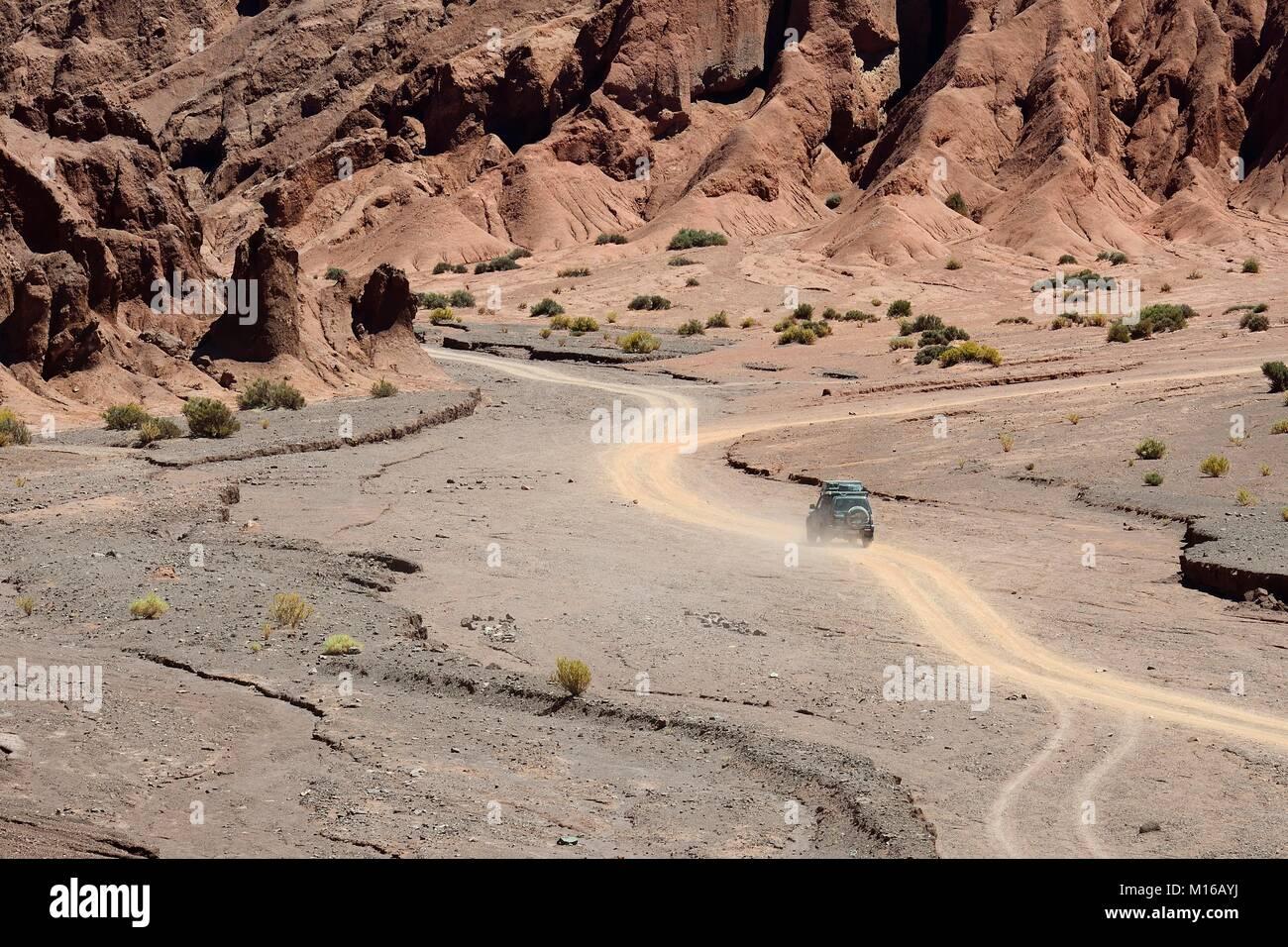 Desert landscape with dirt road in the Rainbow Valley, Valle Arcoiris, near San Pedro de Atacama, Región de - Stock Image
