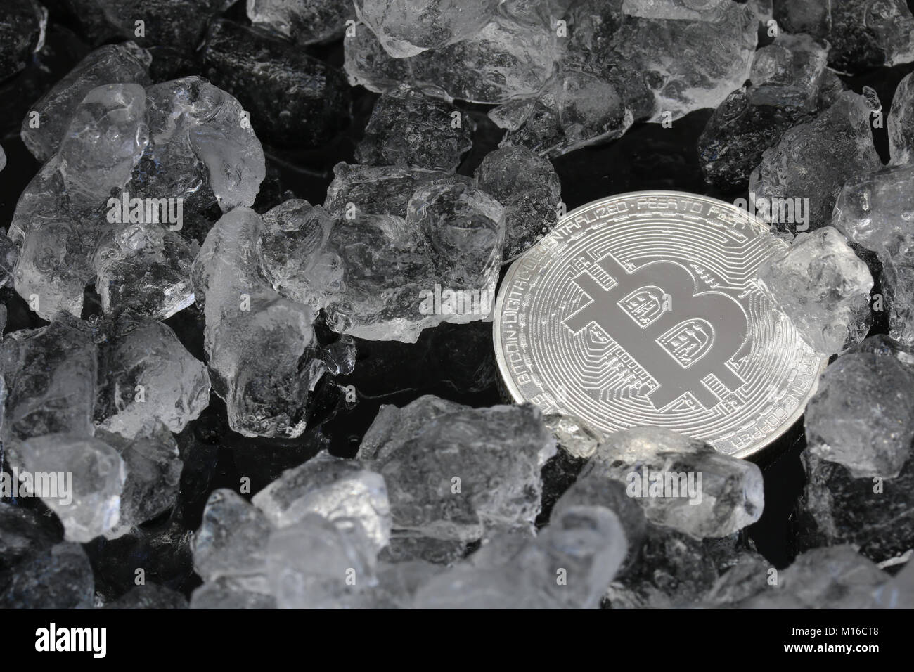 bitcoin on crushed ice background - Stock Image