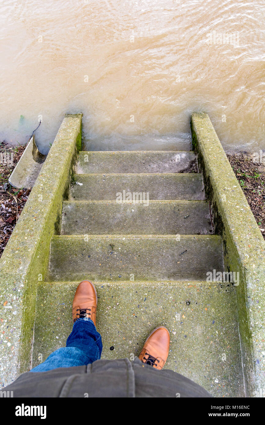 View from above of the stairs descending to the banks of the river Marne flooded halfway up by the important rise - Stock Image