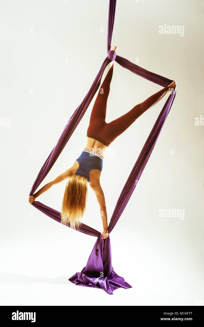 Aerial acrobat rectangle element hanged fabric - Stock Image