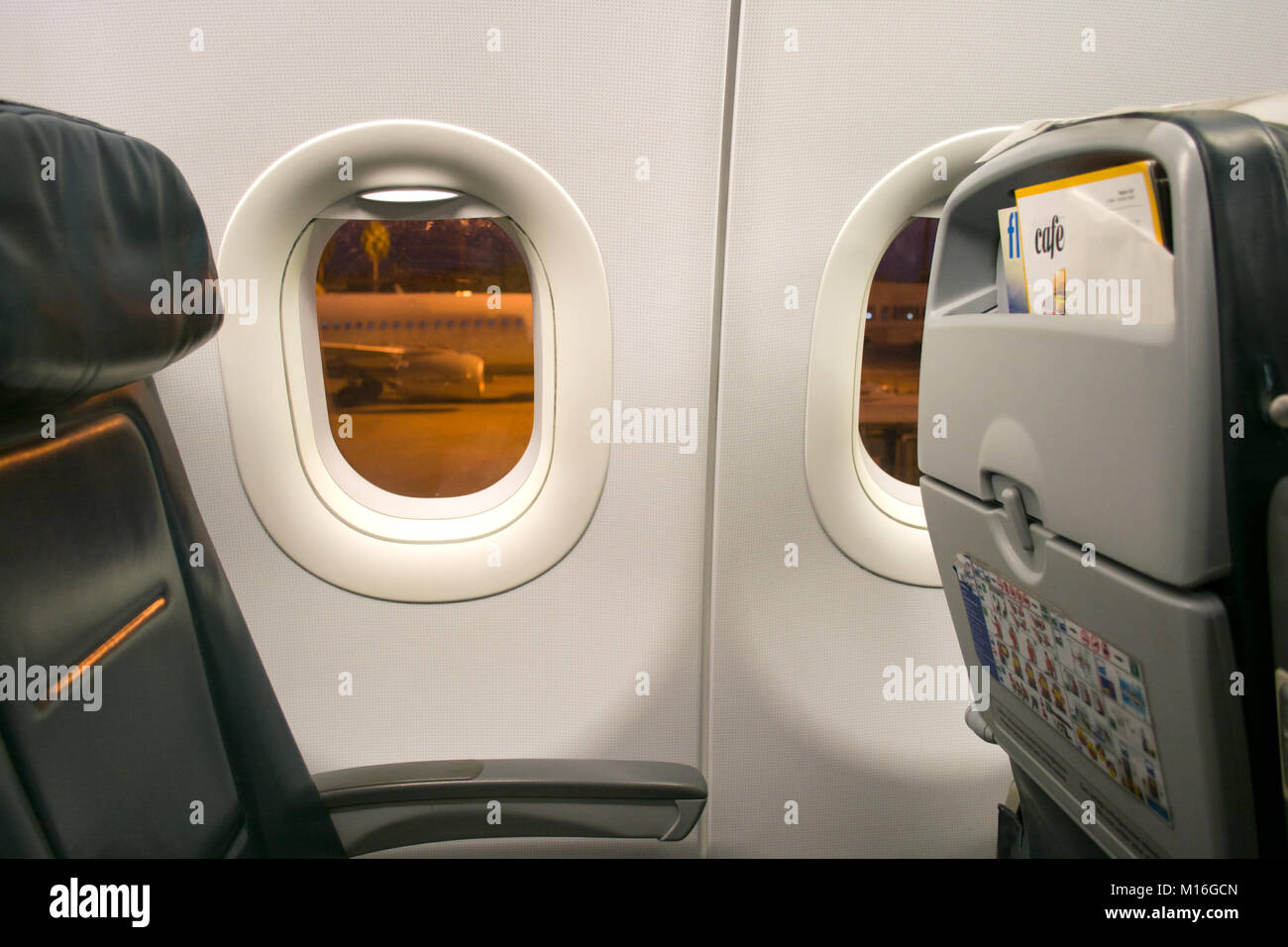 airplane seat and window inside an aircraft Stock Photo