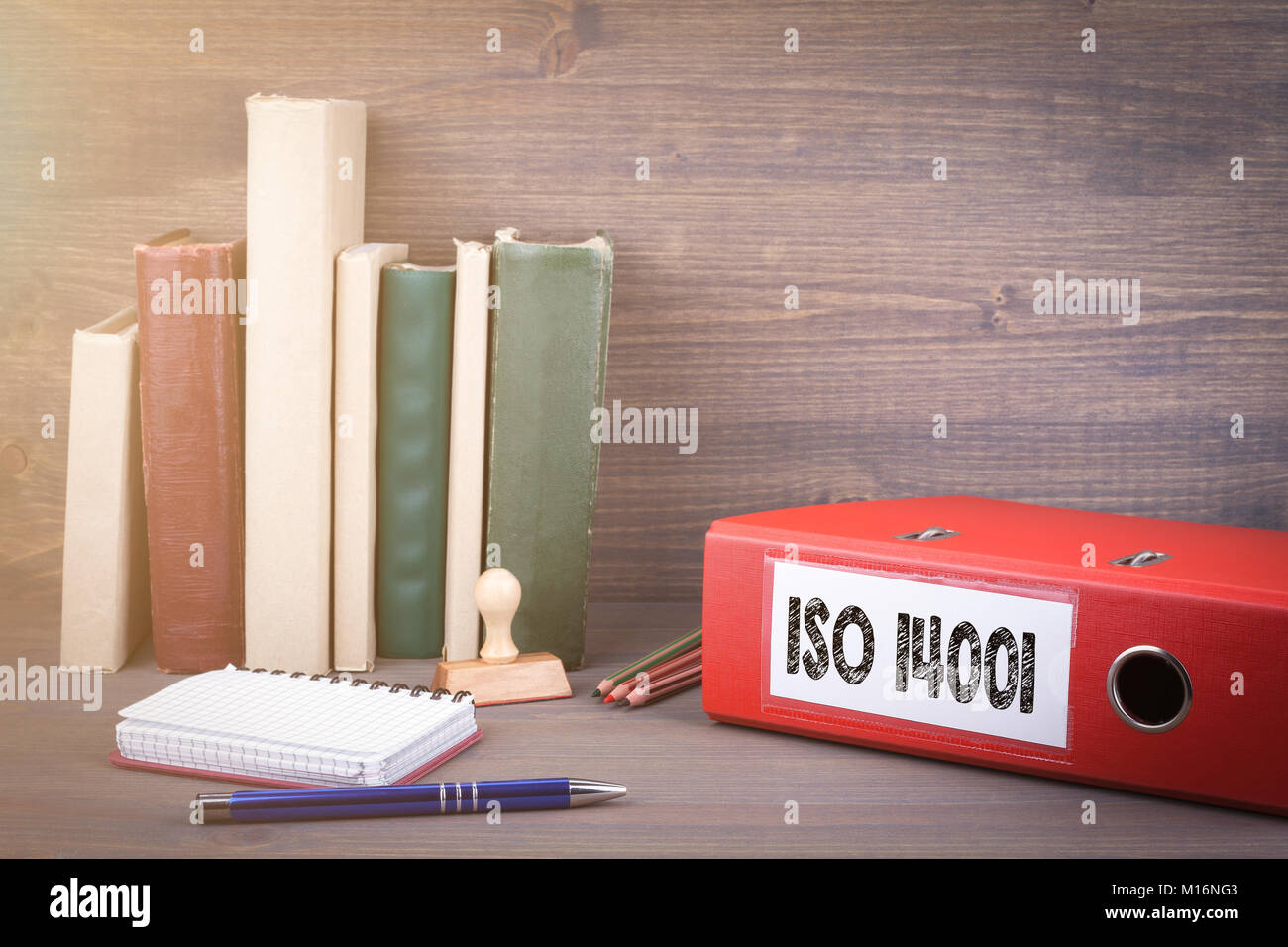 ISO 14001. Binder on desk in the office. Business background - Stock Image