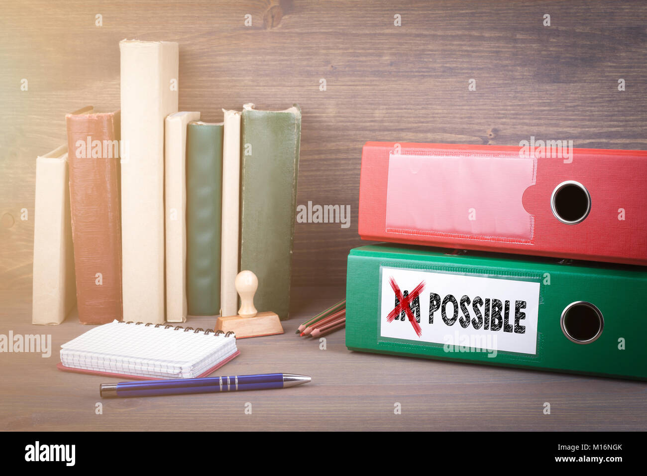 Change impossible to possible. Binder on desk in the office. Business background  - Stock Image