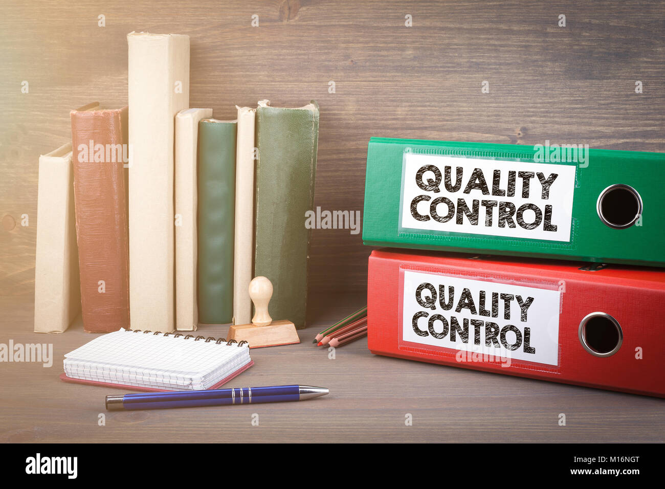 Quality Control. Binders on desk in the office. Business background - Stock Image