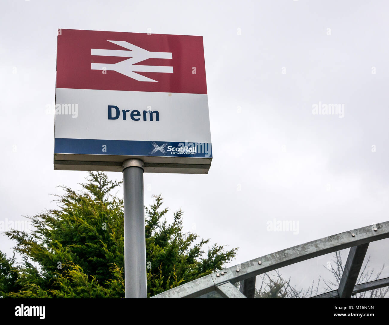 Close up of Drem train station ScotRail sign, with network logo, Drem, East Lothian, Scotland, United Kingdom - Stock Image