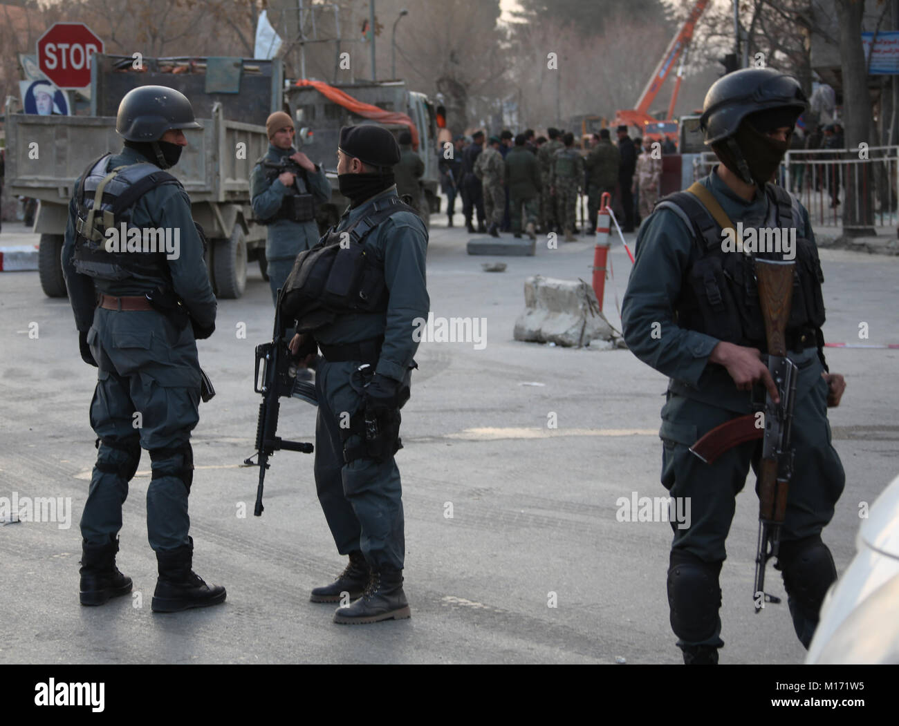 Kabul, Afghanistan. 27th Jan, 2018. Security force members stand guard at the blast site in Kabul, Afghanistan, - Stock Image