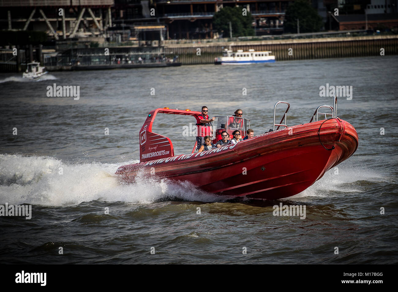 Tourists enjoy a high speed white knuckle ride on the River Thames in a RIB (Rigid Inflatable Boat) - Stock Image