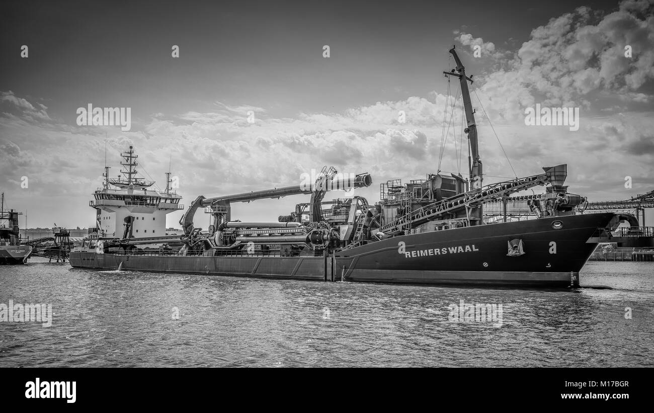 Gravel Dredger, Reimerswaal unloads its cargo while moored in the Thames Estuary, River Thames London England - Stock Image