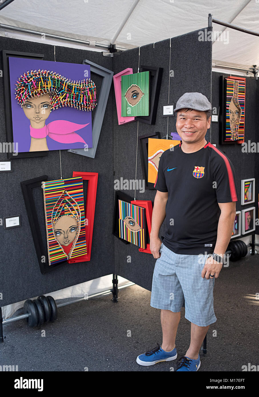 Portrait of Chinese artist Sip Tshun Ng who uses color pencils in his work. At an outdoor art fair in Dleray Beach, - Stock Image