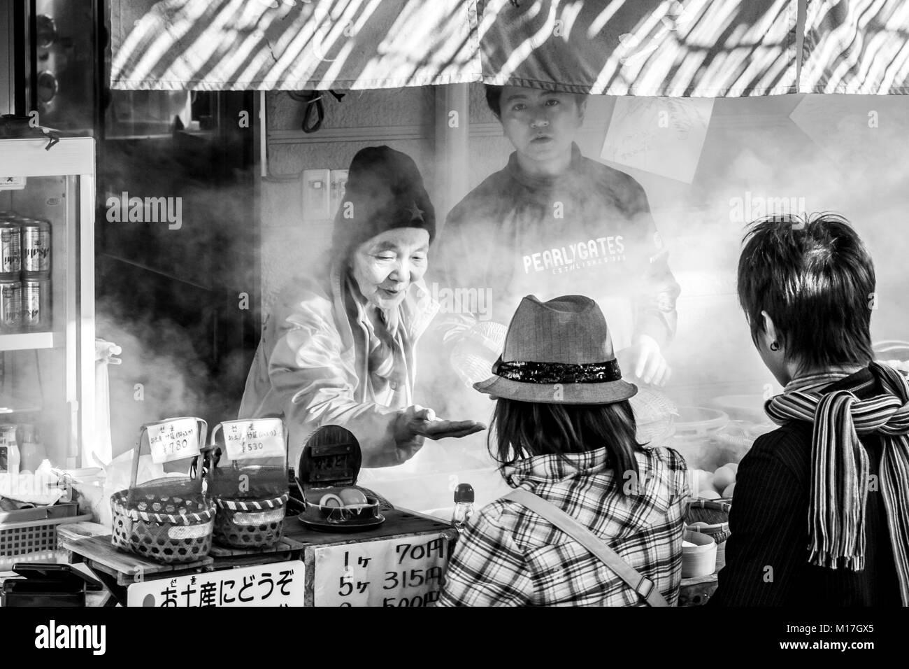 Beppu, Japan. Street food vendor selling boiled eggs popular fast food in Beppu. Black and white image. - Stock Image