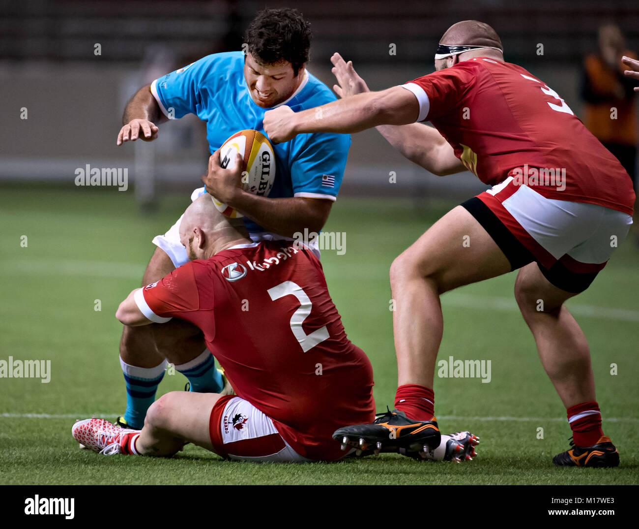 Vancouver, Canada. 27th Jan, 2018. Uruguay's Mario Sagario (L) is stopped by Canada's Ray Barkwill (Bottom) - Stock Image