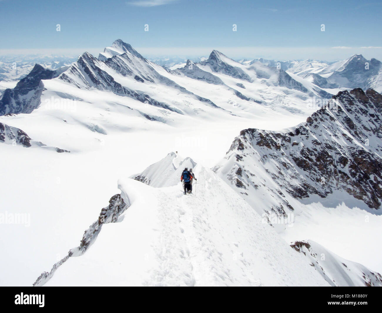 two climbers on Mönch descent with panorama view Stock Photo