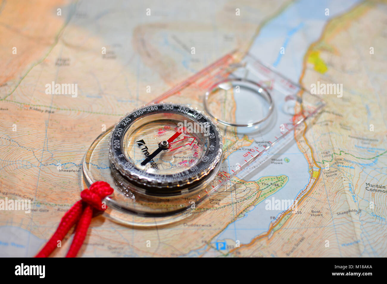 Map reading Compass and Ordinance Survey Map - Stock Image