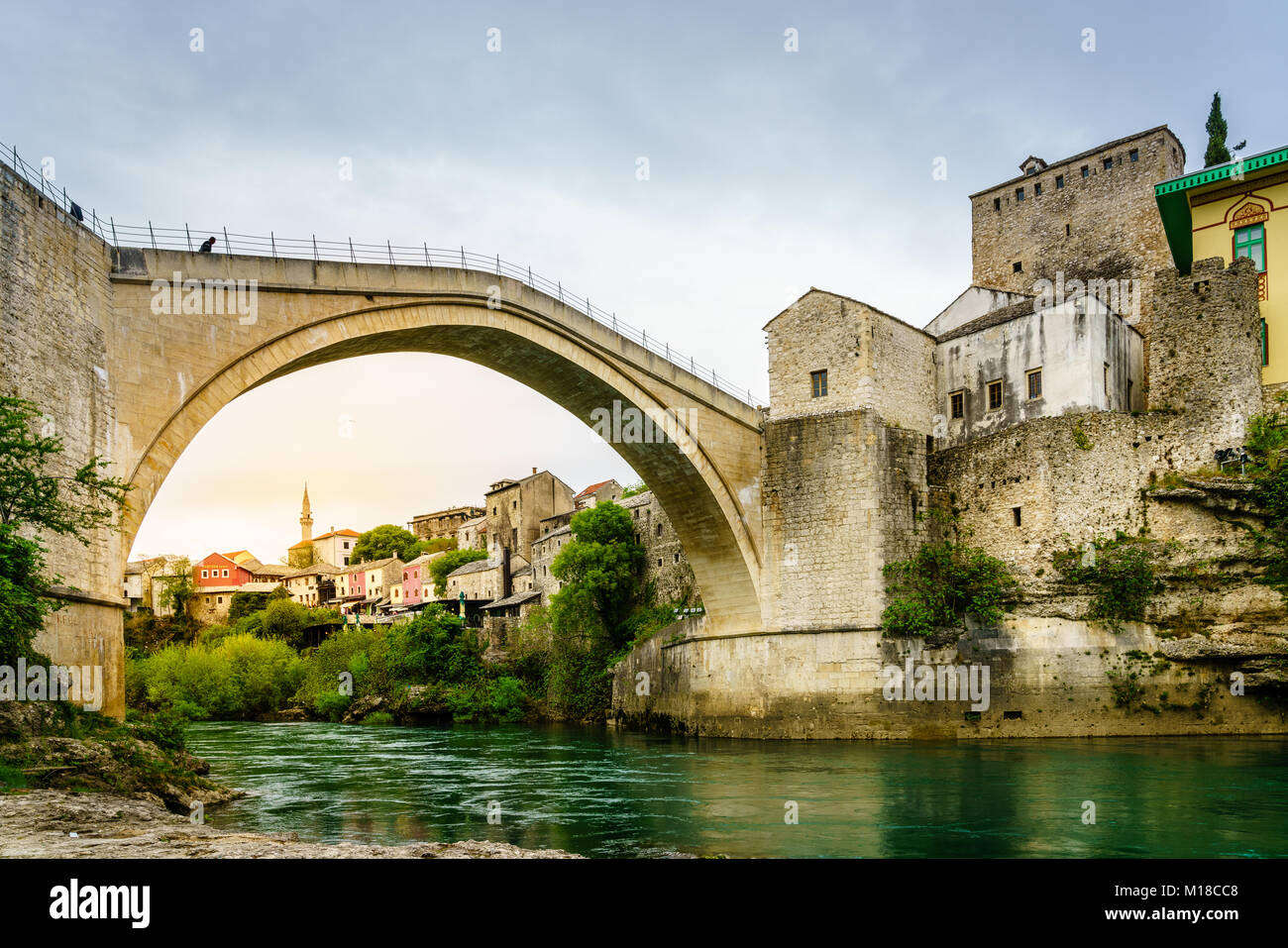 View of famous Mostar Bridge from the bank of Neretva River, Mostar, Bosnia - Stock Image