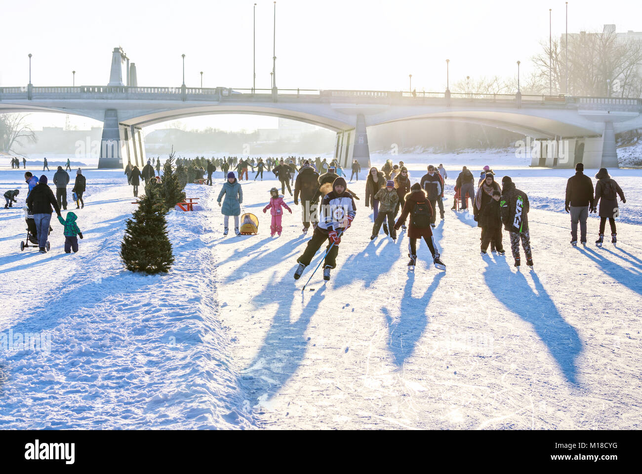 Ice skating on the Red River Mutual Trail, The Forks, Winnipeg, Manitoba, Canada. - Stock Image
