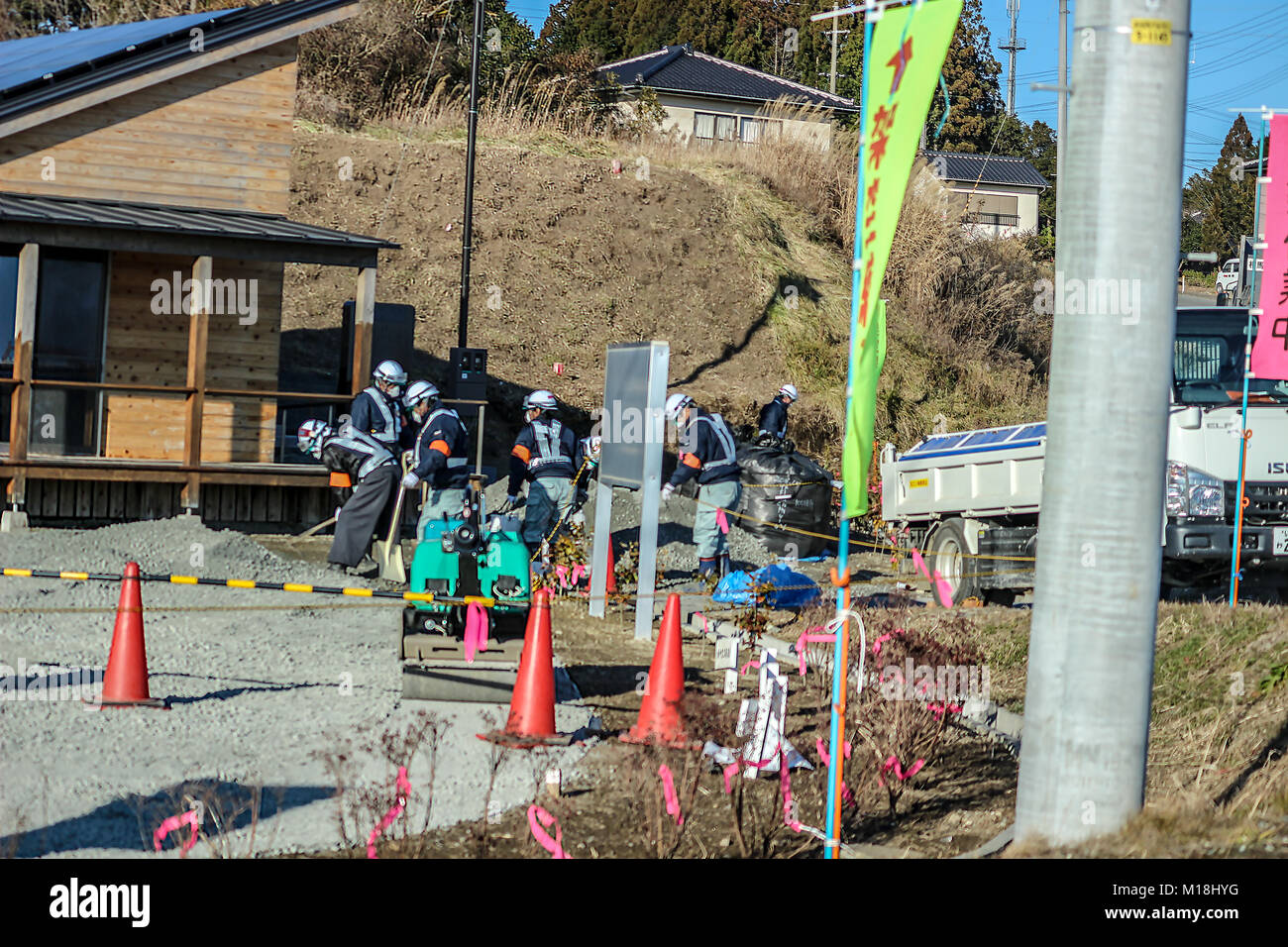 (16, January, 2016, Namie, Fukushima, Japan) Decontamination workers were cleaning contaminated land. Reconstruction - Stock Image