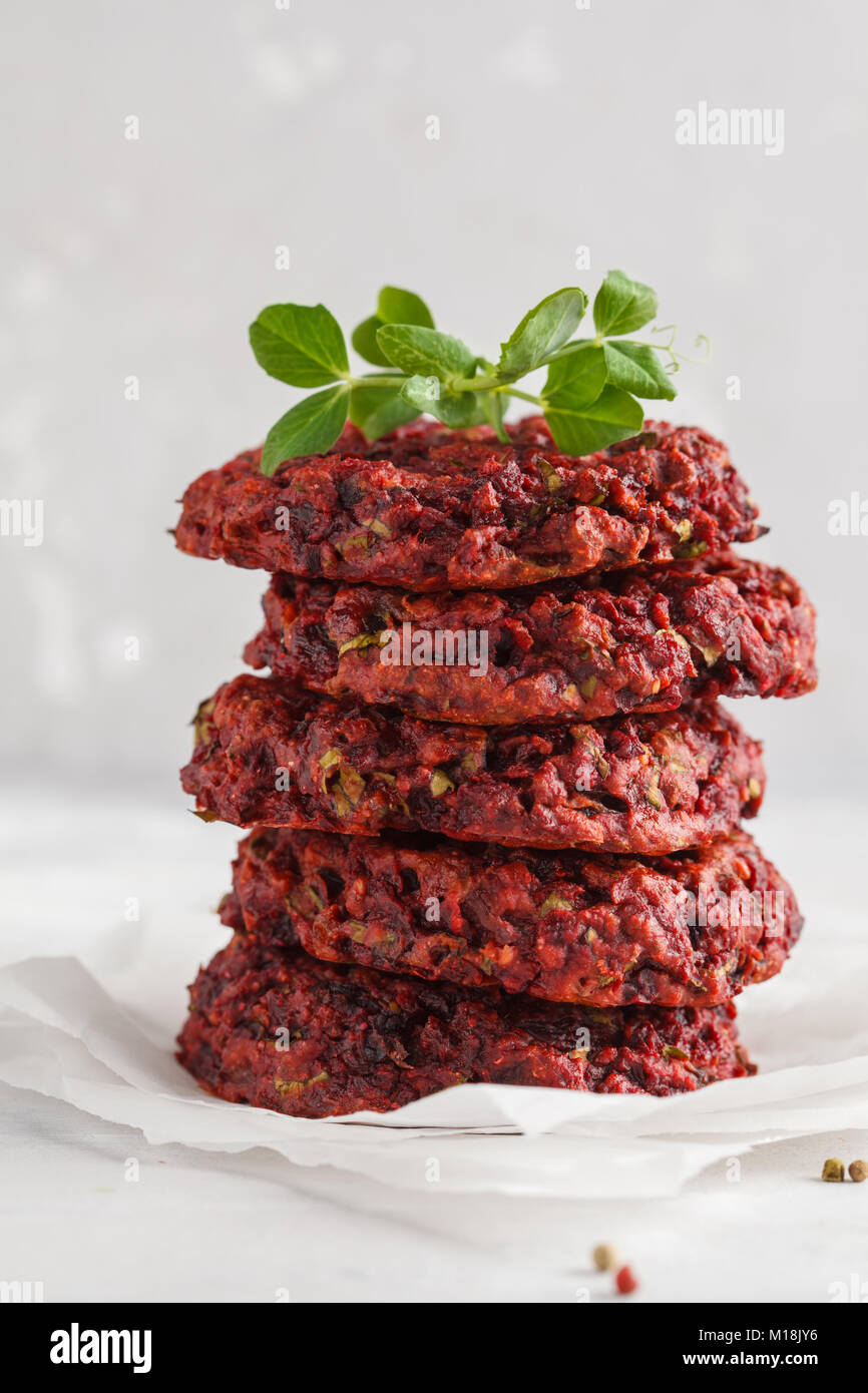 Beetroot vegan burgers with chickpea and herbs. Healthy vegetarian food concept. - Stock Image