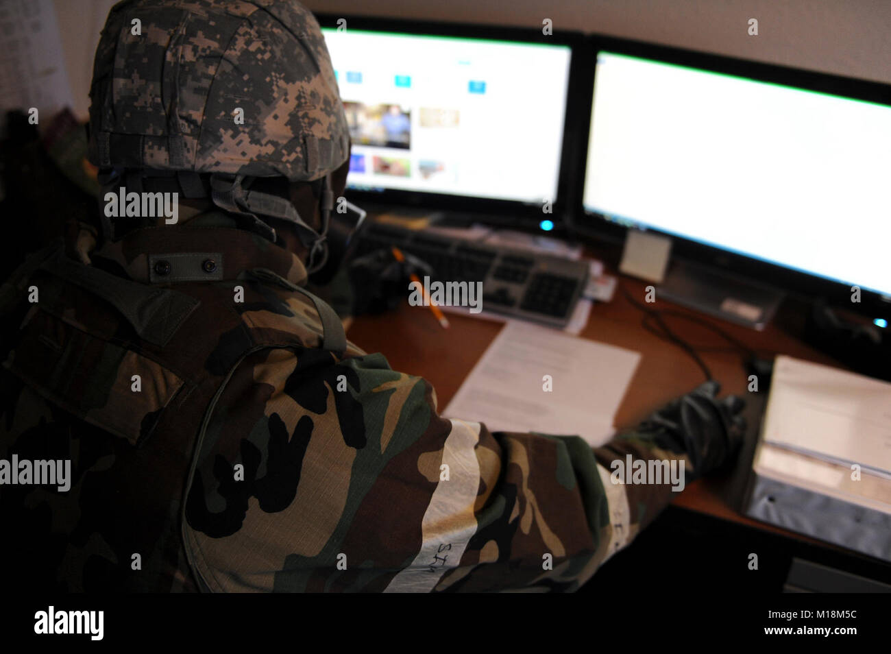 U.S. Air Force Tech. Sgt. Cody Howk, a 354 Operations Support Squadron weather craftsman, updates weather forcasts - Stock Image